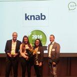 Knab employees receiving Opiness Customer Service Award